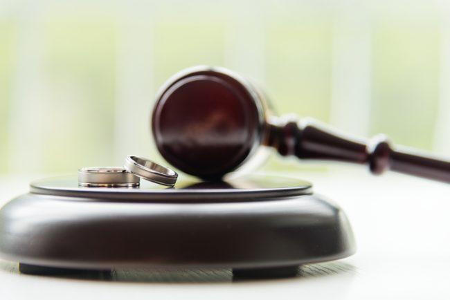 Wedding bands sitting on a judges gavel